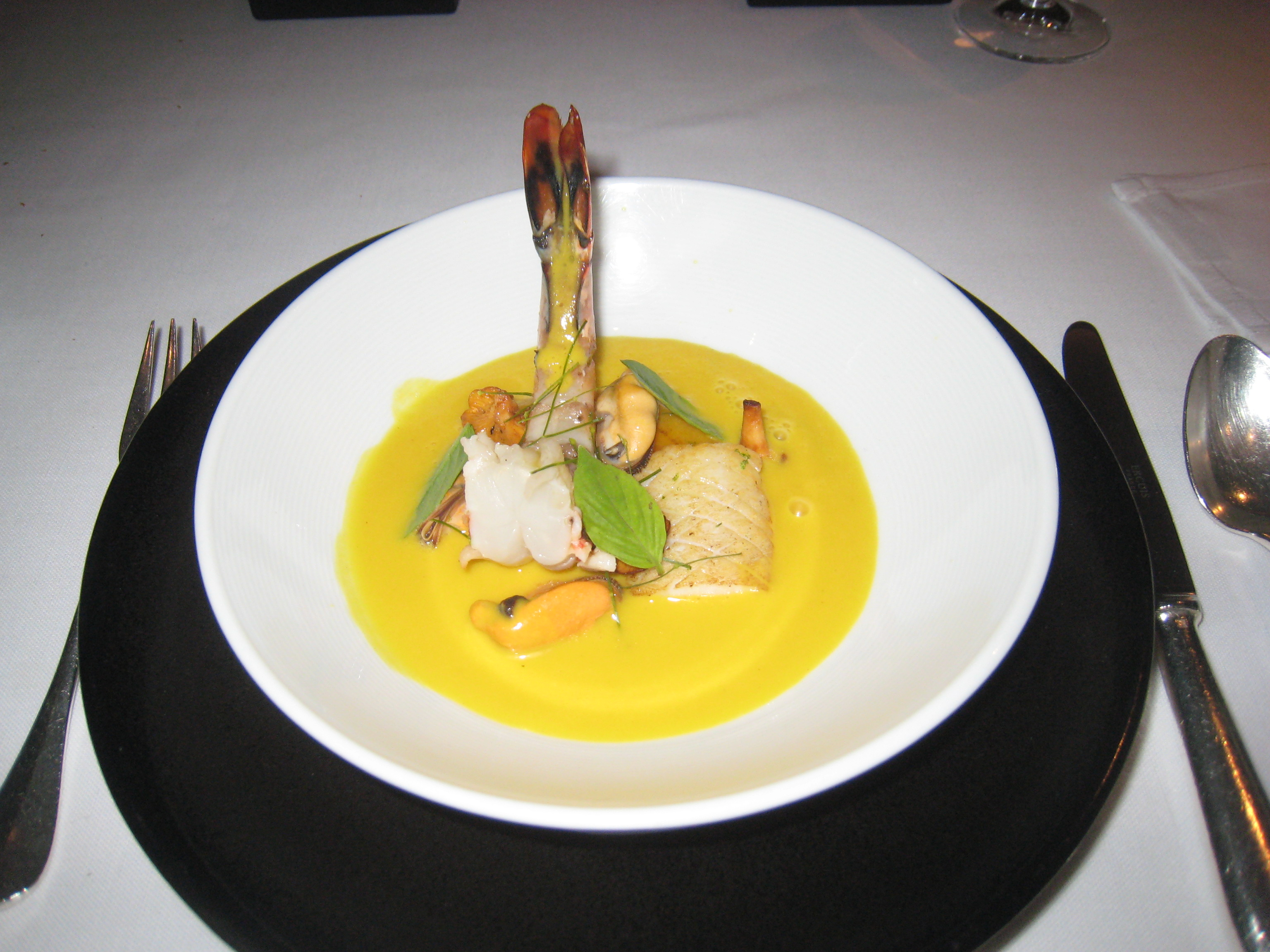 ... mussel velouté; girolle mushrooms, tiger prawn, curry and coconut