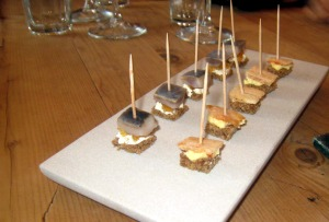 Canapés - Pickled herring; and bacon