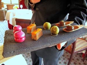 Ledoyen - Amuse Bouche 1: Macaron betterave avec anguille fumé; foie gras, fruit de la passion et tuile d'épices; royale de cèpes et persillade; l'eau de truffe coagulé
