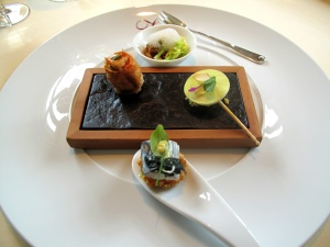 Vendôme - Amuse Bouche - Smoked eel, cumin, cabbage, fig; praline of goat's cheese, watercress; braised poularde, papaya; polenta, mackerel, seaweed, curry mayo
