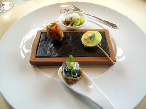Vendôme - Amuse Bouche - Smoked eel, cumin, cabbage, fig; praline of goat's cheese, watercress; braised poularde, papaya; polenta, mackerel, seaweed, curry mayo